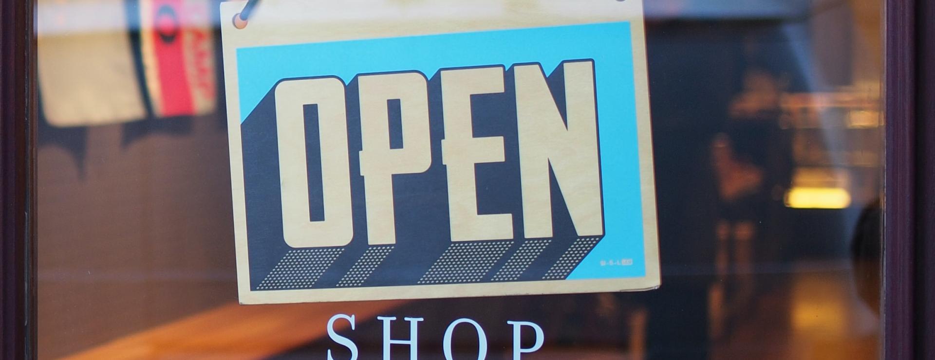 Blue open sign in shop window