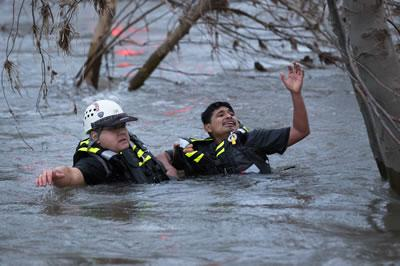 Chico Firefighter rescuing someone