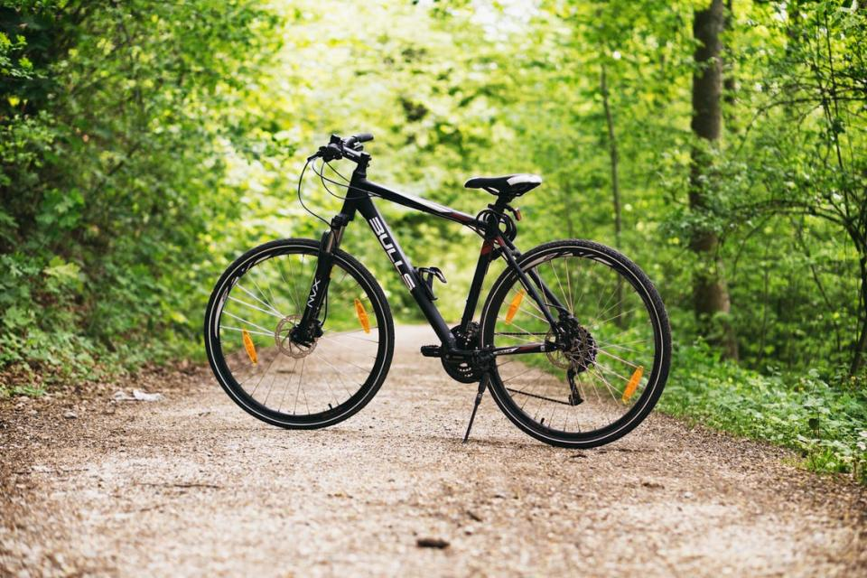 black mountain bike on trail
