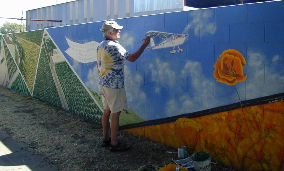 An artist working on his portion of the mural.