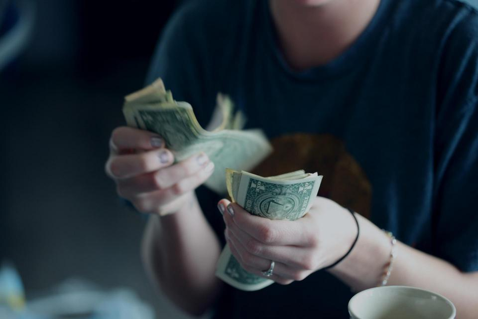 woman counting paper money