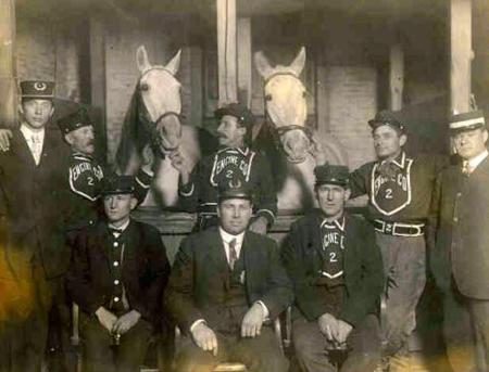 Old photo of firefighters with horses